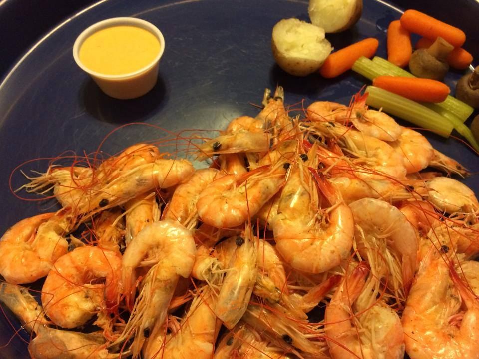 large amount of boiled shrimp on platter