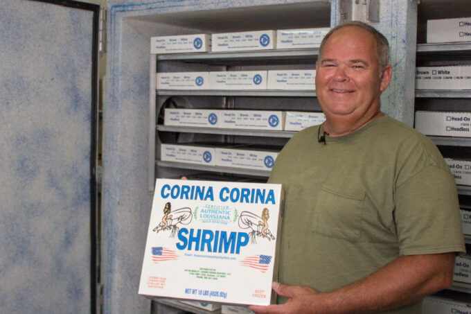 Bryan Mobley holding box of shrimp